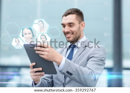 smiling businessman with tablet pc outdoors - stock photo