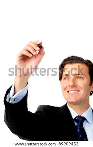 Smiling businessman writes with a marker, copyspace for own text and diagram - stock photo