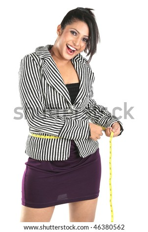 Smiling Businesswoman for loosing her weight - stock photo