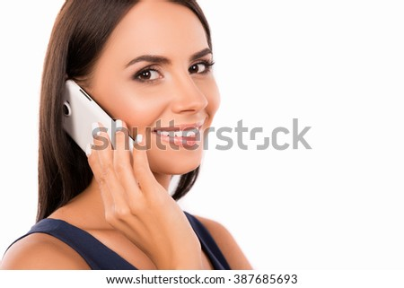 Smiling businesswoman having a conversation and holding phone - stock photo