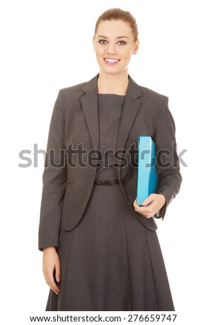Smiling businesswoman holding a binder. - stock photo
