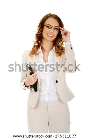 Smiling businesswoman holding a note. - stock photo