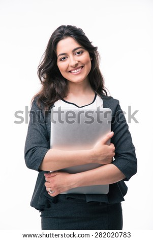 Smiling businesswoman holding laptop isolated on a white background. Looking at camera - stock photo