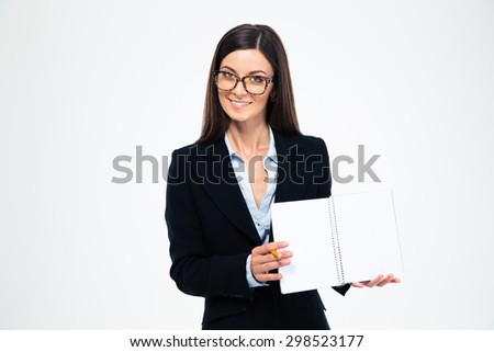 Smiling businesswoman in glasses showing blank notebook isolated on a white background. Looking at camera - stock photo