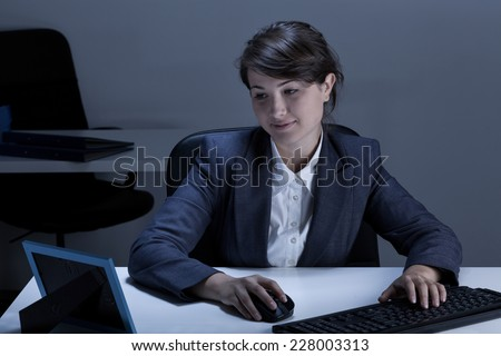 Smiling businesswoman looking at picture in a frame - stock photo
