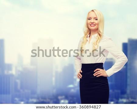 smiling businesswoman or secretary over city - stock photo