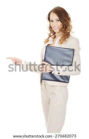 Smiling businesswoman pointing with clipboard. - stock photo