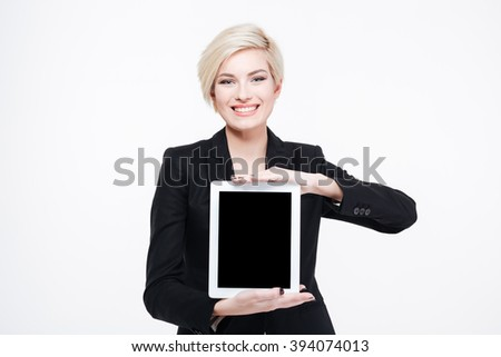 Smiling businesswoman showing blank tablet computer screen isolated on a white background - stock photo