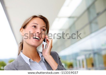 Smiling businesswoman talking on mobile phone - stock photo