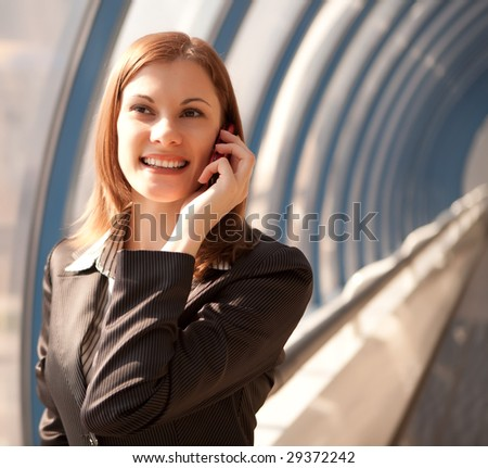 Smiling businesswoman talking on the phone - stock photo