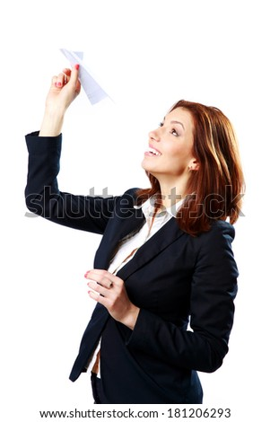 Smiling businesswoman throwing paper plane isolated on a white background - stock photo