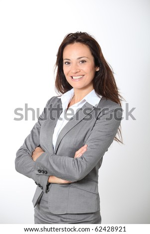 Smiling businesswoman with arms crossed - stock photo