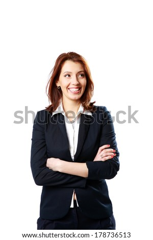 Smiling businesswoman with arms folded looking away isolated on a white background - stock photo