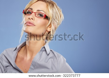 Smiling businesswoman with glasses looking at the camera - stock photo
