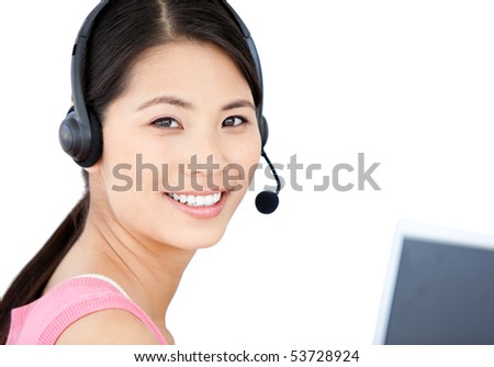 Smiling businesswoman with headset on against a white background - stock photo