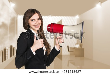 Smiling businesswoman with megaphone. Office Thumb up - stock photo