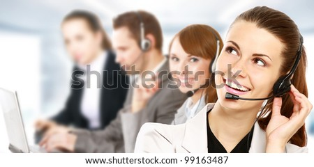 Smiling call center - stock photo