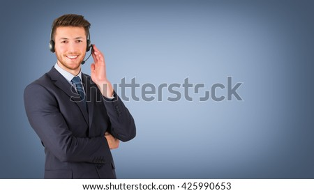 Smiling call center employee during a telephone conversation - stock photo
