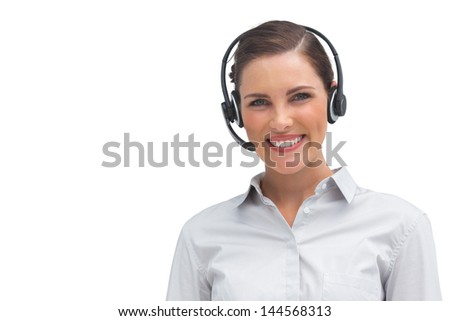Smiling call centre agent with headset on a white background - stock photo