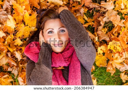smiling carefree lying ground younger mother - stock photo