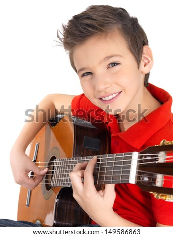 Smiling caucasian boy is playing on acoustic guitar - isolated on white background - stock photo
