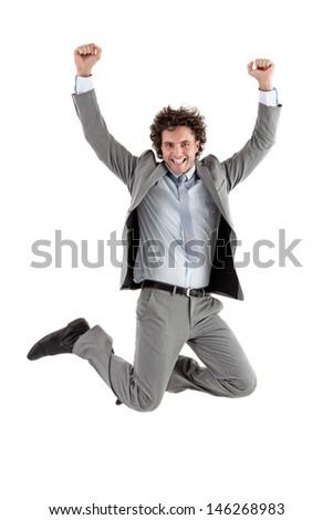 Smiling Caucasian businessman jumping for joy. - stock photo