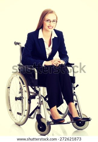 Smiling caucasian businesswoman on a wheelchair - stock photo