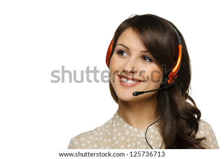 Smiling cheerful support phone operator woman in headset looking to the side at blank copy space, isolated on white background - stock photo