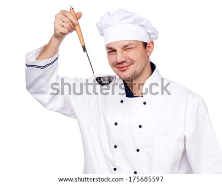 Smiling chef in uniform holding soup ladle on white background - stock photo