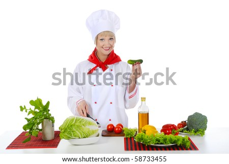smiling chef with a cucumber. Isolated on white background - stock photo