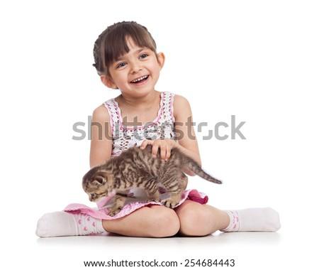 smiling child girl holding cat kitten isolated - stock photo