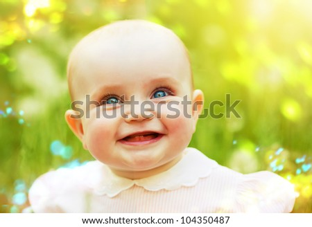 smiling child on the field - stock photo