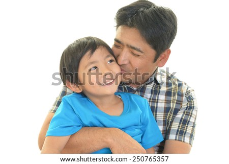 Smiling child with father - stock photo