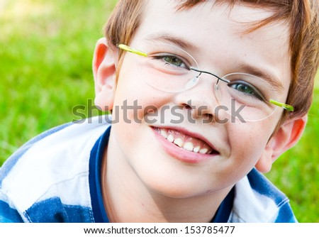 Smiling child with glasses - stock photo