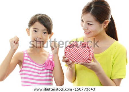 Smiling child with mother - stock photo