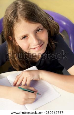 smiling child writes - stock photo