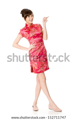 Smiling Chinese woman dress traditional cheongsam at New Year, studio shot isolated on white background. - stock photo