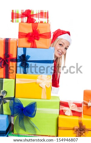 Smiling Christmas woman hiding behind many presents, isolated on white background. - stock photo