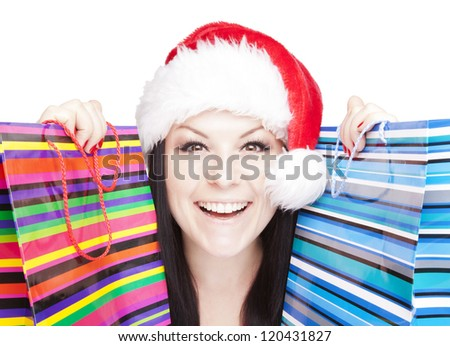 smiling christmas woman holding shopping bags isolated over white background - stock photo