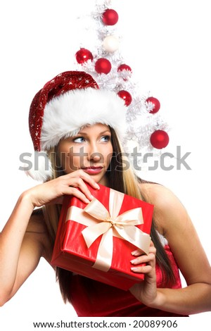 smiling christmas woman on white background with a gift and a tree - stock photo
