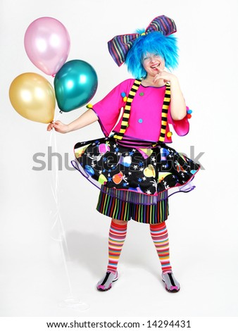 Smiling clown with tree balloons in her hand - stock photo