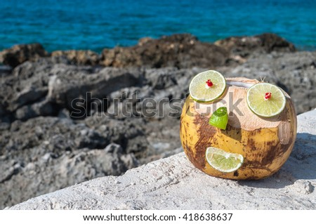 Smiling Coconut on a beach in Cozumel, Mexico. - stock photo