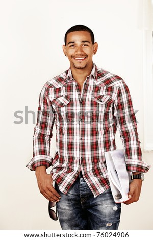 Smiling college guy - stock photo