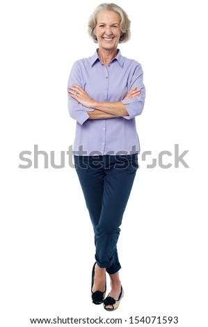 Smiling confident aged woman posing casually - stock photo
