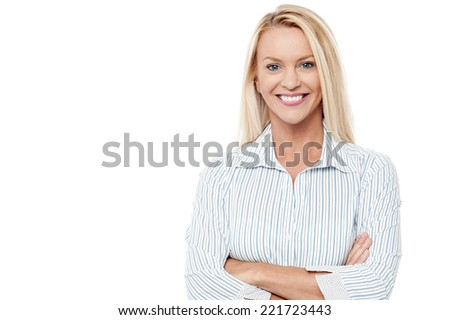 Smiling confident businesswoman with folded arms - stock photo