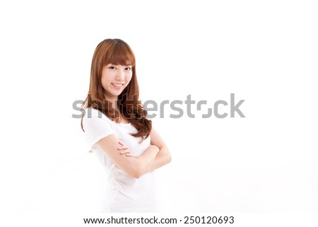 smiling, confident woman crossing her arms, studio shot - stock photo