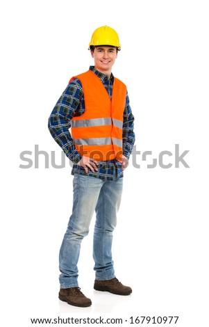 Smiling construction worker in yellow helmet and orange waistcoat.  Full length studio shot isolated on white. - stock photo