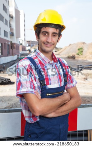 Smiling construction worker with black hair - stock photo
