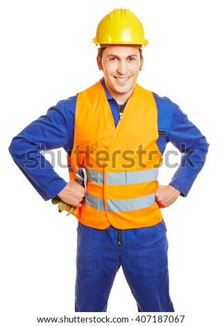 Smiling construction worker with hardhat and safety vest and protective gloves - stock photo