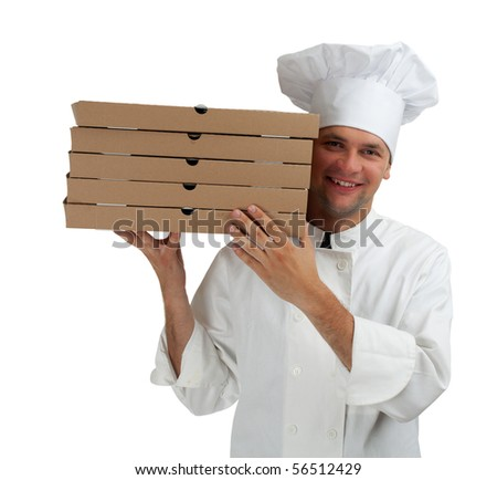 smiling cook in white uniform and hat with boxes of pizza - stock photo